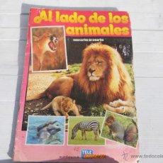 Coleccionismo Álbumes: ALBUM DE CROMOS ( AL LADO DE LOS ANIMALES ). Lote 47066324
