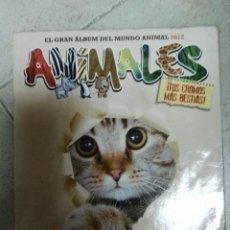 Coleccionismo Álbumes: ALBUM CROMOS ANIMALES 2012 CON 86. Lote 83500696