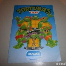 Coleccionismo Álbumes: ALBUM TORTUGAS NINJA DE DANONE CON 4 CROMOS. Lote 108386975