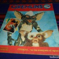 Coleccionismo Álbumes: BUEN PRECIO, GREMLINS INCOMPLETO CON 44 CROMOS DE 180. PANINI 1984.. Lote 135691623