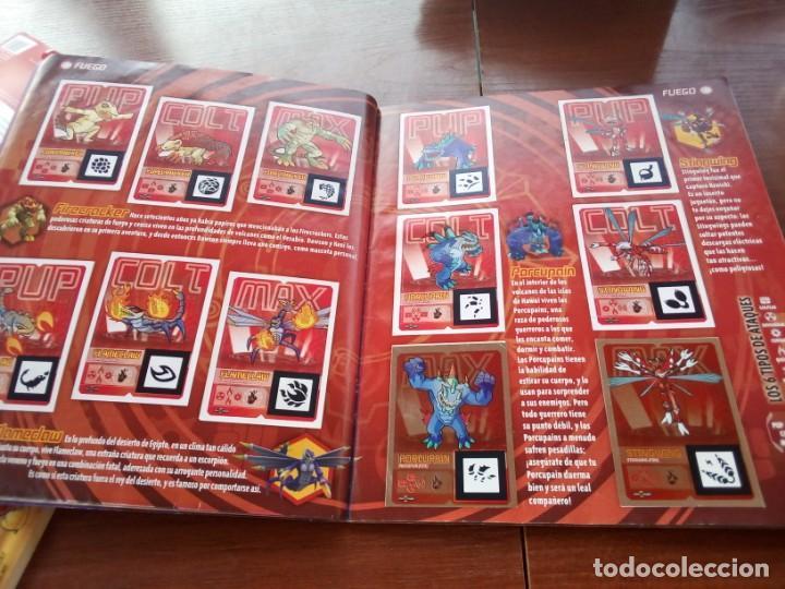 Coleccionismo Álbumes: Album Invizimals faltan unos 20 cromos + 38 para cambios - Foto 3 - 169826744