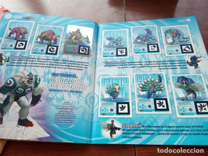 Coleccionismo Álbumes: Album Invizimals faltan unos 20 cromos + 38 para cambios - Foto 8 - 169826744