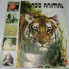 Coleccionismo Álbumes: ALBUM CROMOS MUNDO ANIMAL 1984, FHER , CON 58 CROMOS DE 121. Lote 178622253