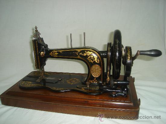 Antigua maquina de coser singer a manivela con - Vendido
