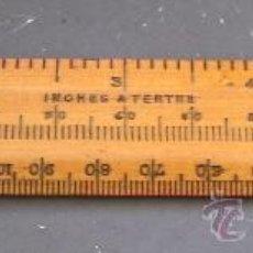 Antigüedades: PEQUEÑA REGLA DE MADERA EN MEDIDAS IMPERIALES Y METRICAS (16X2,5CM APROX). Lote 26280968