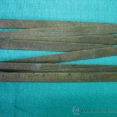 Antigüedades: METRO ANTIGUO EN BRONCE. Lote 28893409