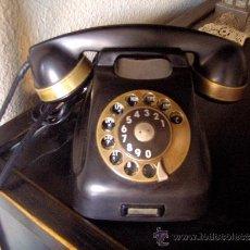 Teléfonos: TELEFONO DE SOBREMESA ANTIGUO.COLOR NEGRO CON REMATES EN COBRE.. Lote 31091504