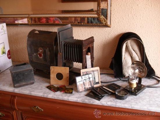 Antigüedades: importante linterna magica,con fotos cristal,muchas fotos mirala,tambien camara fotos - Foto 15 - 32333349