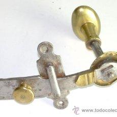 Antigüedades: ANTIGUO ABRIDOR DE HIERRO Y BRONCE. Lote 37306364