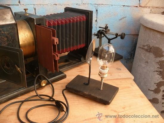 Antigüedades: enorme linterna magica con fotos cristal,funciona,mirala hay muchas fotos - Foto 3 - 33985804
