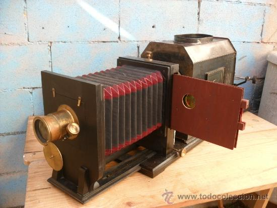 Antigüedades: enorme linterna magica con fotos cristal,funciona,mirala hay muchas fotos - Foto 2 - 33985804