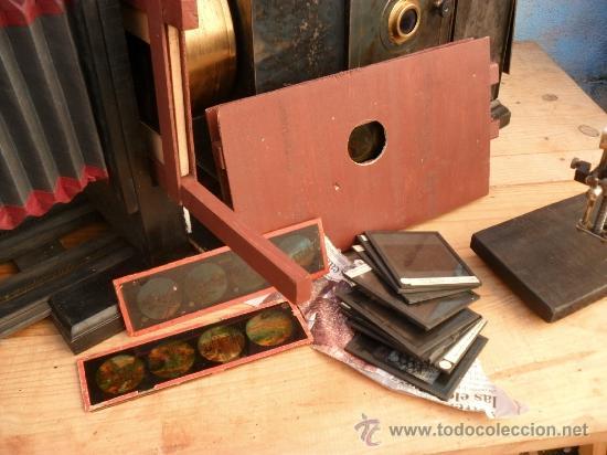 Antigüedades: enorme linterna magica con fotos cristal,funciona,mirala hay muchas fotos - Foto 10 - 33985804