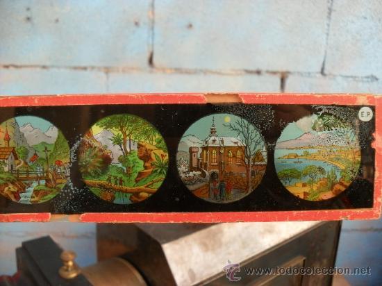 Antigüedades: enorme linterna magica con fotos cristal,funciona,mirala hay muchas fotos - Foto 15 - 33985804