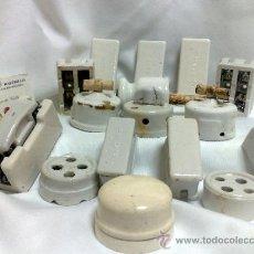 Antigüedades: LOTE DE ANTIGUOS INSTRUMENTOS ELÉCTRICOS EN PORCELANA.. Lote 102262738