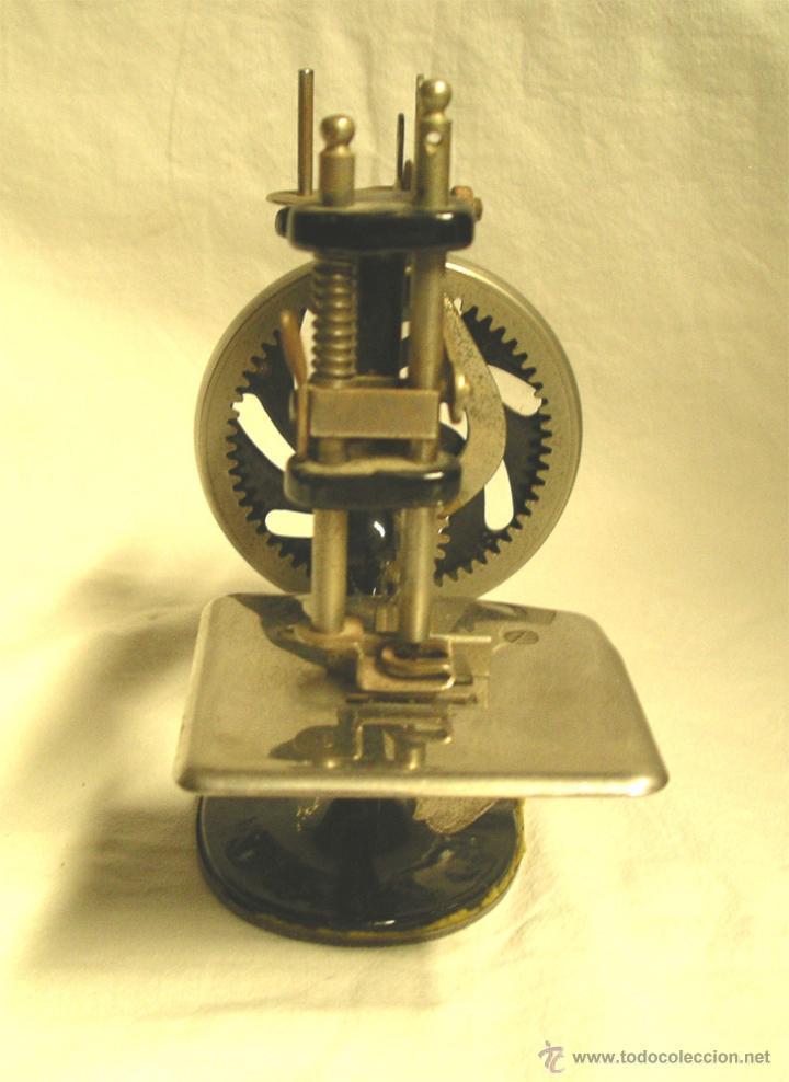 Antigüedades: Maquina de coser Singer USA nº 20, hierro litografiado, con manual instrucciones. - Foto 2 - 50715886