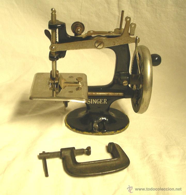 Antigüedades: Maquina de coser Singer USA nº 20, hierro litografiado, con manual instrucciones. - Foto 3 - 50715886