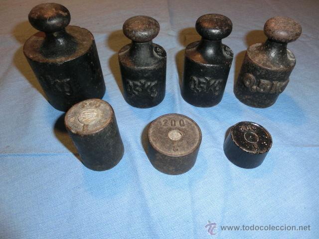 ANTIGUO JUEGO DE PESAS EN HIERRO FUNDIDO 7UD (Antigüedades - Técnicas - Medidas de Peso Antiguas - Otras)