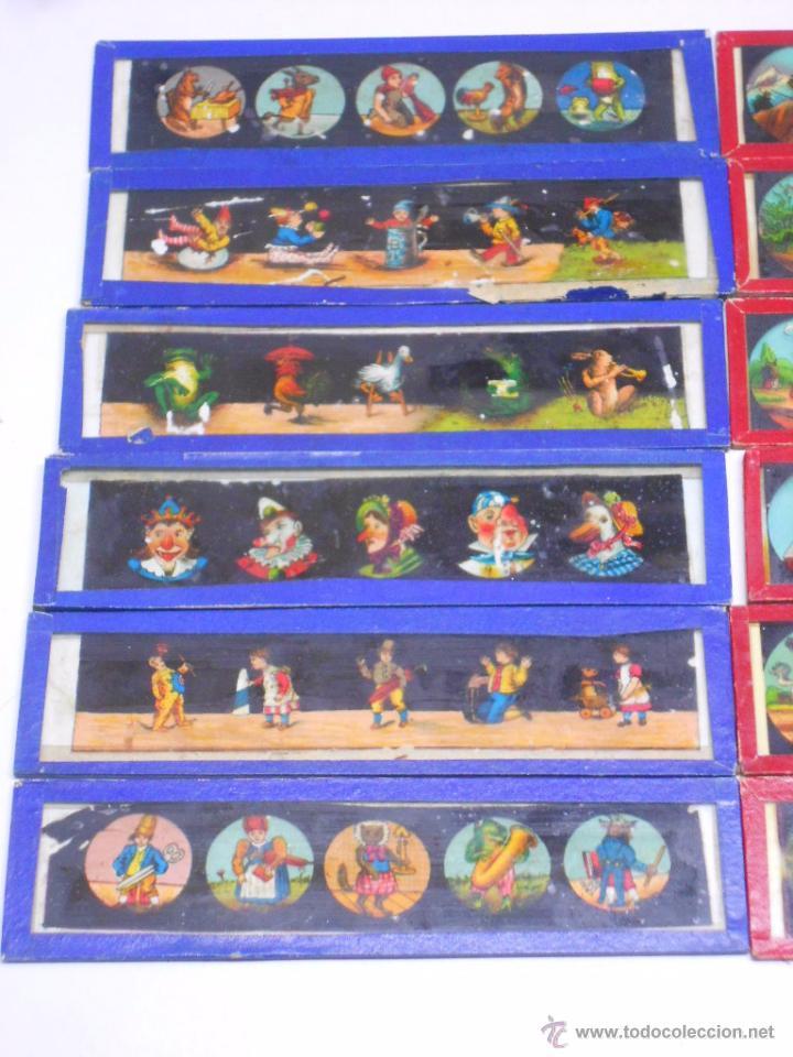 Antigüedades: CAJA CON 24 PLACAS DE CRISTAL PINTADAS DE LA LINTERNA MAGICA. SIGLO XIX. 13X3.5 Y 14X3.5 CMS - Foto 2 - 105790824