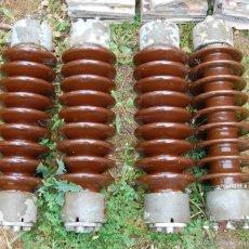 Antigüedades: AISLADOR DE ELECTRICIDAD DE PORCELANA RENFE // LOTE DE CUATRO. Lote 208859625