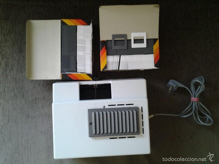 Antigüedades: REVUE 300 Proyector diapositivas + 11 carros para diaposit. + 200 soportes ( 2 cajas ) -- ver fotos - Foto 3 - 58215376