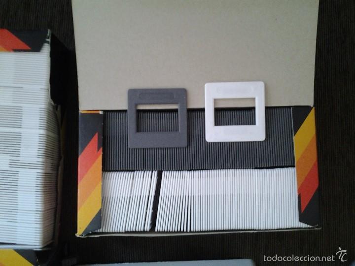 Antigüedades: REVUE 300 Proyector diapositivas + 11 carros para diaposit. + 200 soportes ( 2 cajas ) -- ver fotos - Foto 10 - 58215376