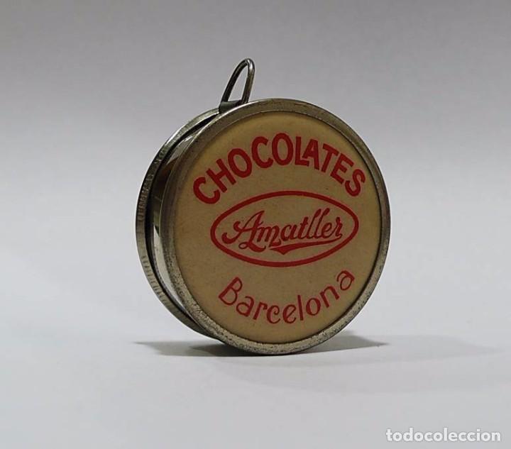 Antigüedades: Antigua cinta métrica en metal cromado - Publicidad Chocolates Amatller Barcelona - Foto 2 - 67935881