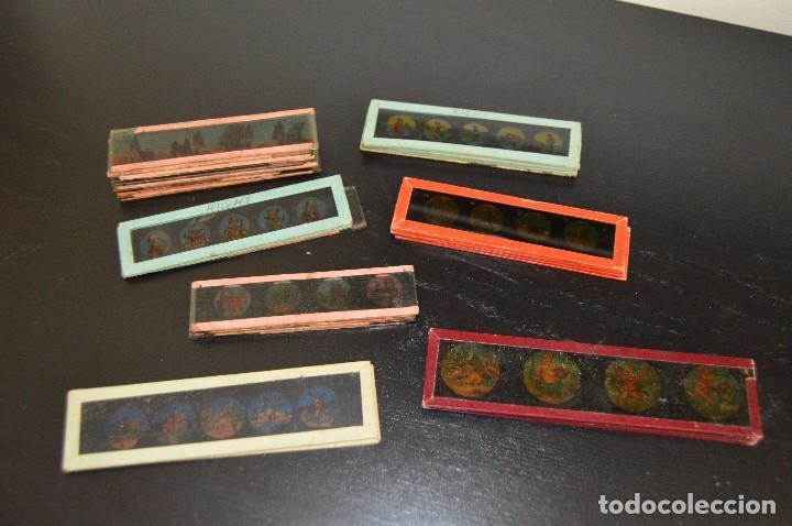 LOTE DE 34 CRISTALES DE LINTERNA MÁGICA, 14, 13 Y 11 CM DE LARGO. ORIGINALES. (Antigüedades - Técnicas - Aparatos de Cine Antiguo - Linternas Mágicas Antiguas)