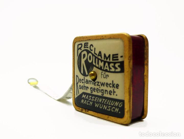Antigüedades: Cinta métrica de metal cromado y celuloide con publicidad - Reclame Rollmass Alemania- años 30 - Foto 2 - 100752923