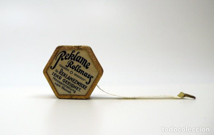 Antigüedades: Cinta métrica de metal cromado y celuloide con publicidad - Reclame Rollmass Alemania- años 30 - Foto 3 - 100753027