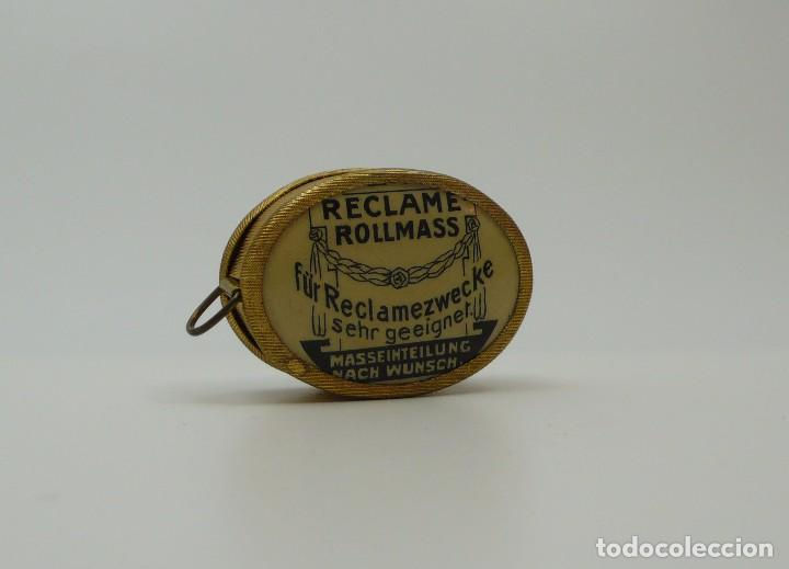 Antigüedades: Cinta métrica de metal cromado y celuloide con publicidad - Reclame Rollmass Alemania- años 30 - Foto 2 - 100754263