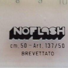 Antigüedades: NOFLASH. ANTIRREFLECTANTE. REGLA 50CM, AÑOS 80. A ESTRENAR EN BLISTER ORIGINAL. Lote 103932211