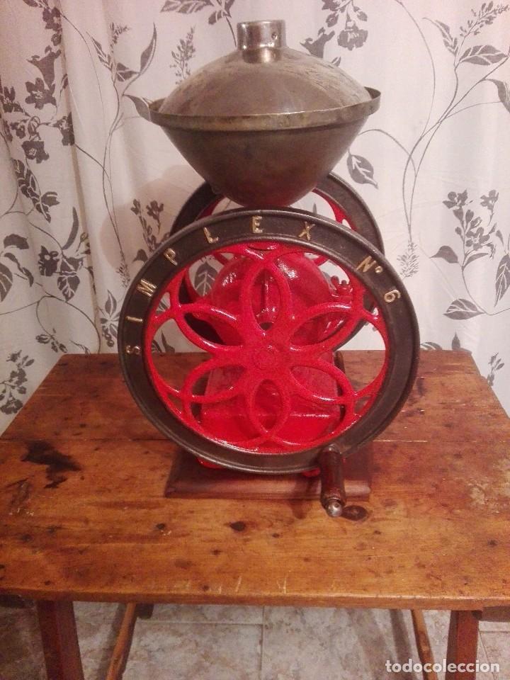 Antigüedades: Antiguo y precioso molinillo de cafe de dos ruedas marca simplex número 6 - Foto 5 - 244527940