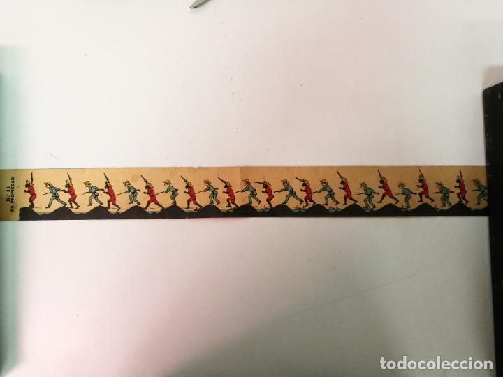 PELICULA ANTIGUA DE ZOOTROPO, LA GUERRA DE CUBA.MIDE 55CM.X5,5CM. (Antigüedades - Técnicas - Aparatos de Cine Antiguo - Zootropos Antiguos)
