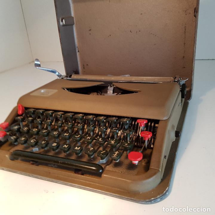 Antigüedades: Maquina de escribir, portatil, fabricada en Italia, antigua, funciona - ver video ! - Foto 15 - 140250730