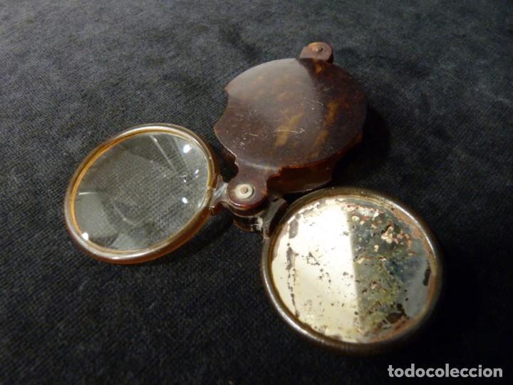 Antigüedades: ANTIGUA LUPA Y ESPEJO DE BOLSILLO. CELULOIDE IMITACIÓN CAREY. 7x4,7 cm. AÑOS 20. PLEGABLE. LENTE - Foto 2 - 140556666