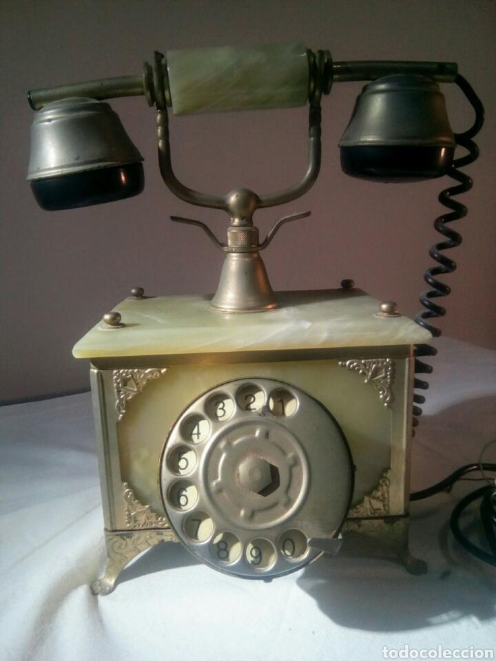 ANTIGUO TELÉFONO. METAL DORADO Y ONIX (Antigüedades - Técnicas - Teléfonos Antiguos)