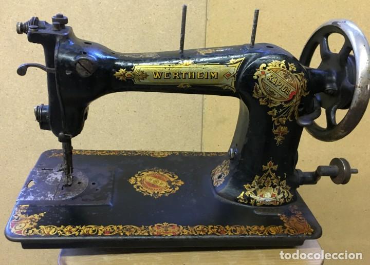 Antigua maquina de coser wertheim, profusamente - Vendido