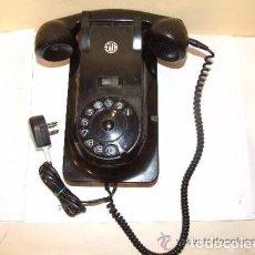 Teléfonos: TELEFONO ANTIGUO DE BAKELITA Y HIERRO, COMPLETO MARCA PTT. Lote 145011814