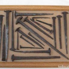 Antigüedades: CUADRO CON 20 CLAVOS ANTIGUOS DE HIERRO FORJADOS A MANO. SIGLO XVII -XVIII.. Lote 145925310