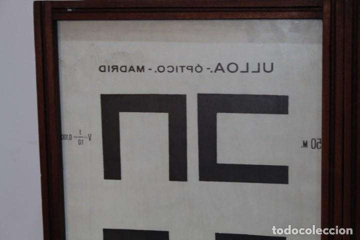 Antigüedades: Magnifico Optometro Ulloa Optico Madrid, símbolos a dos caras e iluminados, muy cuidado - Foto 10 - 149522486
