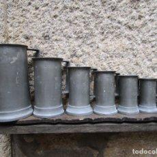 Antigüedades: JUEGO DE 7 MEDIDAS PARA LIQUIDOS EN ESTAÑO, APROX 1920/30, EXCELENTE CONSERVACION + INFO. Lote 172033109