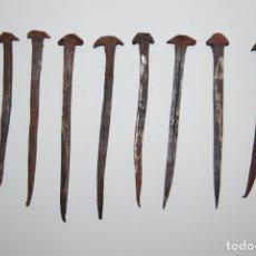 Antigüedades: OCHO CLAVOS DE HIERRO FORJADO - FORJA - SIGLO XVIII - DE 18 A 21 CM.. Lote 182718083