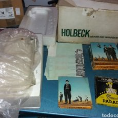 Antigüedades: HOLBECK AUTOMATIC ZOOM MOVIE PROJECTOR + CINTA. Lote 182751553