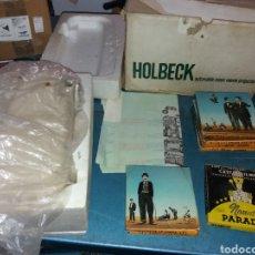 Antigüedades: HOLBECK AUTOMATIC ZOOM MOVIE PROJECTOR + CINTA. Lote 182751553