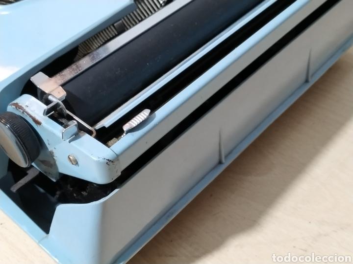 Antigüedades: Máquina de escribir portátil Remington Holiday azul - años 60 - Foto 4 - 193569868