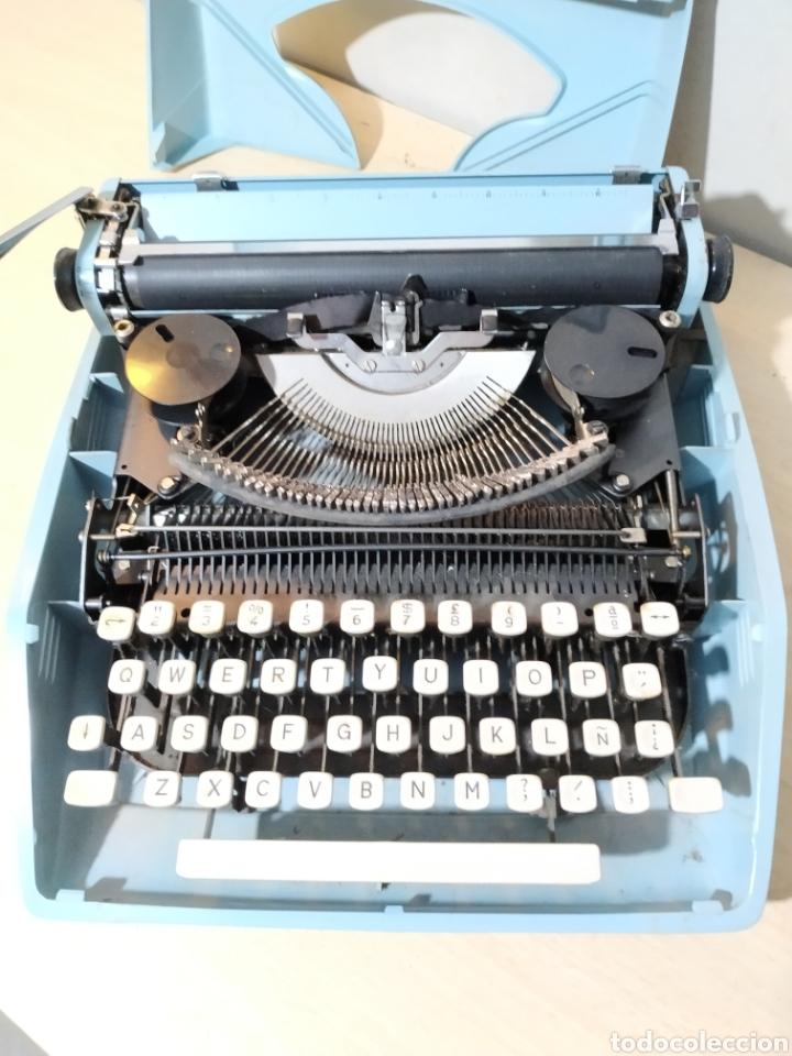 Antigüedades: Máquina de escribir portátil Remington Holiday azul - años 60 - Foto 12 - 193569868