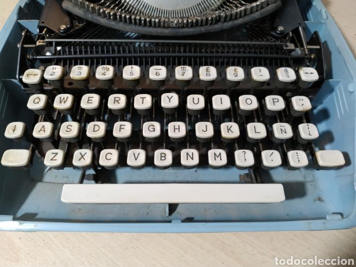 Antigüedades: Máquina de escribir portátil Remington Holiday azul - años 60 - Foto 13 - 193569868