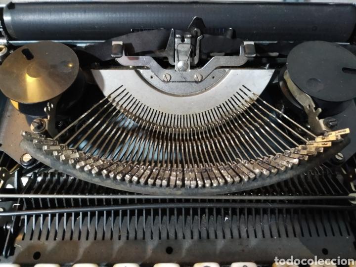 Antigüedades: Máquina de escribir portátil Remington Holiday azul - años 60 - Foto 14 - 193569868