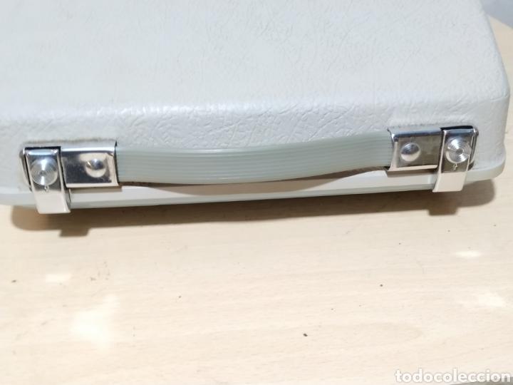 Antigüedades: Máquina de escribir portátil Remington Holiday azul - años 60 - Foto 17 - 193569868