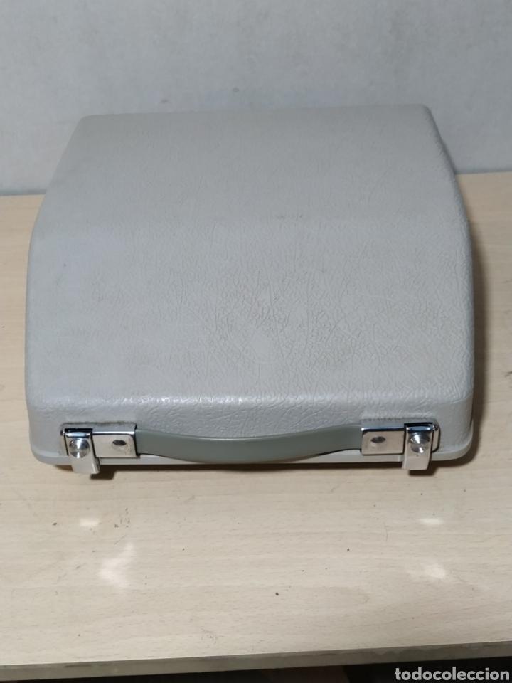 Antigüedades: Máquina de escribir portátil Remington Holiday azul - años 60 - Foto 18 - 193569868